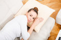Young woman relaxing on the couch a lying sofa Royalty Free Stock Photography