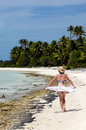 Young woman relaxing on deserted tropical island sexy walks a with palm trees in aitutaki lagoon cook islands Royalty Free Stock Images