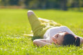 Young woman relaxing on grass. Rear view Royalty Free Stock Images
