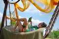 Young woman relaxing in hammock Royalty Free Stock Photo