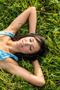 Young woman relaxing in meadow Royalty Free Stock Photo
