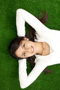 Young woman relaxing outdoor serene in fresh grass Stock Image