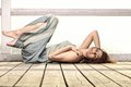 Young woman is relaxing on the pier full length in morning summer holiday Royalty Free Stock Photo