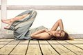Young woman is relaxing on the pier full length in morning summer holiday Royalty Free Stock Photography
