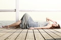 Young woman is relaxing on the pier full length in morning summer holiday Stock Photos