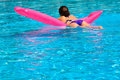 Young woman relaxing in pool Royalty Free Stock Photo