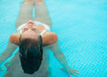 Young woman relaxing in pool. rear view Stock Photography
