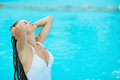 Young woman relaxing at poolside Royalty Free Stock Images