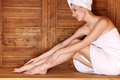 Young woman relaxing in sauna Royalty Free Stock Photo