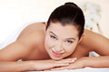 Young woman relaxing in spa saloon Royalty Free Stock Image