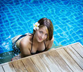 Young woman relaxing in a swimming pool portrait of Royalty Free Stock Photo