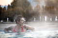 Young woman relaxing in thermal pool. Royalty Free Stock Photo