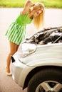 Young woman repairing car Royalty Free Stock Photo