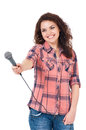 Young woman reporter holding a microphone isolated on white background Stock Photography