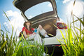 Young woman resting in car Royalty Free Stock Photo