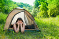 Young woman resting in a tent Stock Image