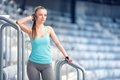 Young woman resting at training preparing for marathon jogging and running concept fitness trainer resting between sets on stai Stock Photo