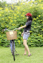 Young woman with retro bicycle in a park outdoor portrait Royalty Free Stock Images