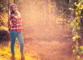 Young woman with retro photo camera outdoor hipster lifestyle autumn forest nature on background Royalty Free Stock Image