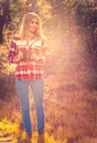 Young woman with retro photo camera outdoor hipster lifestyle autumn forest nature on background Stock Photos