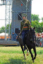 A young woman rides a horse horse riders competition moscow june rider is dressed in vintage military uniform times and ages Royalty Free Stock Photo