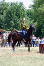A young woman rides a horse horse riders competition moscow june rider is dressed in vintage military uniform times and ages Royalty Free Stock Image