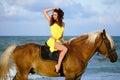 Young woman riding a horse Stock Photos