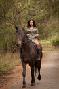 Young woman riding a horse brunette Stock Photography