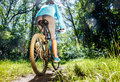 Young woman riding mountain bike on fast ride outdoors Stock Images