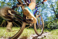 Young woman riding on mountain bike fast ride outdoors Stock Image