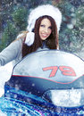 Young woman riding a snowmobile Royalty Free Stock Photo
