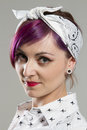 Young woman in rockabilly styles style on a grey background Royalty Free Stock Images