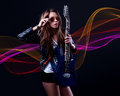 Young  woman rockstar with blue electric guitar Royalty Free Stock Photo