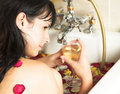 Young woman in rose bath Stock Image