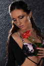 Young woman with rose under rain. Royalty Free Stock Images