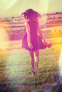 Young woman run across the field Royalty Free Stock Photo