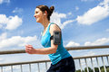 Young woman runing in the city over the brige in sun light smil smiling run Royalty Free Stock Photo