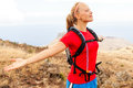 Young woman runner in mountains enjoying summer day with arms outstretched female jogger exercising outdoors nature la gomera Royalty Free Stock Photo