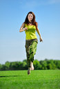 Young woman running on a green meadow Royalty Free Stock Photo
