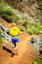 Young woman running in mountains on sunny summer day Royalty Free Stock Photo