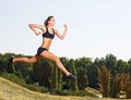Young woman running outdoors Royalty Free Stock Photo
