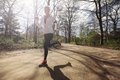 Young woman running outdoors in forest caucasian on a sunny day fit female athlete jogging a park caucasian female model Stock Photos