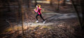 Young woman running outdoors in a forest going fast motion blurred image Royalty Free Stock Photos