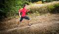 Young woman running outdoors in a forest going fast motion blurred image Royalty Free Stock Image