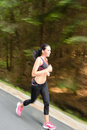 Young woman running outdoors motion blur runner training for marathon run Royalty Free Stock Image