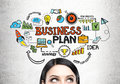 Young woman s head and a business plan
