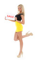Young woman with sale sign beautiful on a white background Royalty Free Stock Images