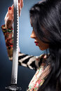 Young woman with samurai sword Stock Photo