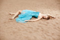 image photo : Young woman on the sand