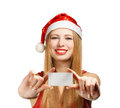 Young woman in santa claus hat with christmas greeting card beautiful suit holding or advertisement isolated on white background Stock Photography